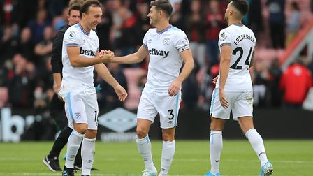 West Ham United's Mark Noble greets team-mate Aaron Cresswell after the final whistle during the Pre