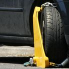 A car incapacitated by a wheel clamp. Picture: PA