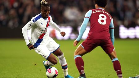 Crystal Palace's Wilfried Zaha (left) and West Ham United's Felipe Anderson battle for the ball duri