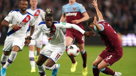 Crystal Palace's Wilfried Zaha (centre) and West Ham United's Aaron Cresswell (right) battle for the