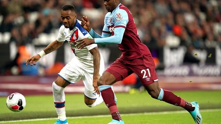 Crystal Palace's Jordan Ayew (left) and West Ham United's Angelo Ogbonna battle for the ball during