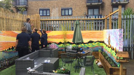 Staff from Newham Ambulance Station and Aston Group creating the garden. Picture: Sophie Morton