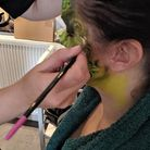 A group of women volunteered for body painting at the Havering Beauty Academy in Hornchurch to raise