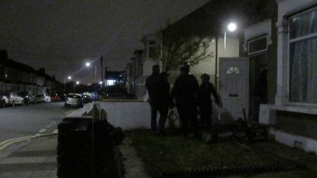 Officers break into a property in Natal Road. Picture: Hannah Somerville