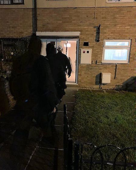 Police officers at an address in Clayhall as part of Operation Linstock. Picture: Met police
