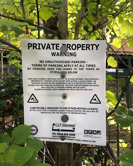 The signs in Friary Lane which outline that the road is private property - neighbours say it is unad