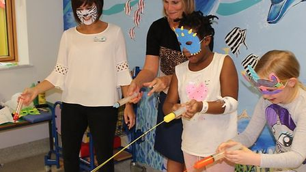 Children enjoying syringe painting at Queen's Hospital during Play in Hospital Week. Picture: BHRUT