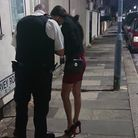 Police officer talking to a sex worker in the Ilford Lane area. Picture: Ellena Cruse