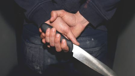 A file image of a person holding a knife. Picture: PA