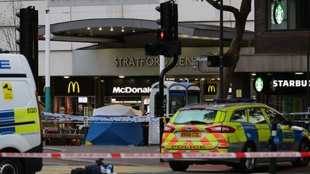 Police in Stratford after a teenager was fatally stabbed. Picture: Aaron Chown/PA Wire