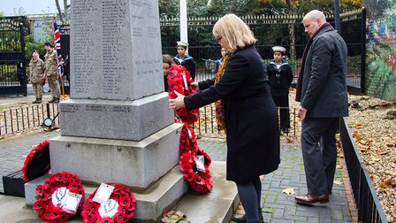 Cllr Rachel Tripp lays a wreath at St Marks Memorial in the grounds of Brick Lane Music Hall last y