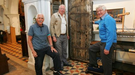 Bill Chumbley, Danny Ager and Frank Byatt pictured in 2013 with the door thought to date back to the