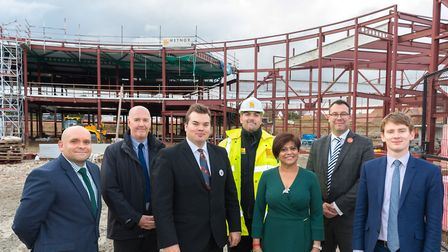 Havering Council representatives, including council leader Cllr Damian White, right, getting an upda