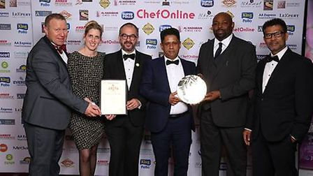The Mother India team celebrating their award win. Picture: Sterling Media