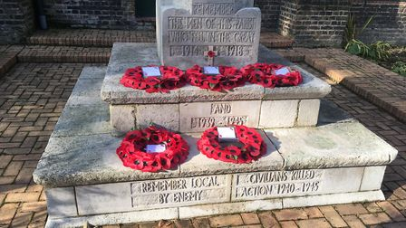 Wreaths on the war memorial at the old St Luke's in Canning Town. Picture: Andrew Brookes