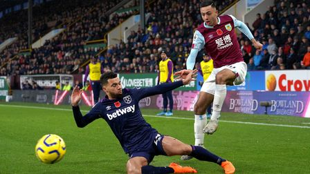 West Ham United's Ryan Fredericks (left) and Burnley's Dwight McNeil battle for the ball during the