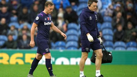 West Ham United's Mark Noble (left) walks off the pitch after a foul against Burnley's Ashley Barnes