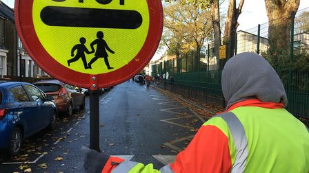 Lollipop lady, Bushra Sultana, looks out on a virtually empty Sebert Road. Picture: Jon King