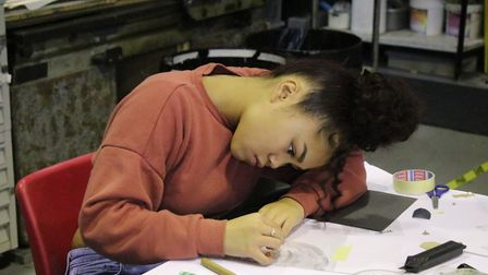 Chloe Rambuyon from Urusline Academy Ilford working on a print. Picture: Rose Russell