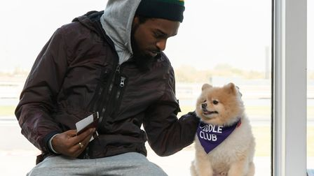 Musician Lickle Jay with Cedric the Pomeranian. Picture: Andrew Baker