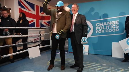 Heavyweight boxer Dereck Chisora with Brexit Party leader Nigel Farage during a party rally at the G