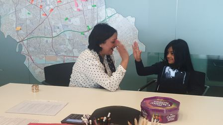 Mayor Rokhsana Fiaz high-fives with her interviewer Jannah Chowdhury, 8. Picture: Roman Road School