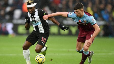 Newcastle United's Allan Saint-Maximin (left) and West Ham United's Declan Rice battle for the ball