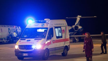 An ambulance carrying Tafida Raqeeb, five, leaves Genoa Airport in Italy as she is transported to th