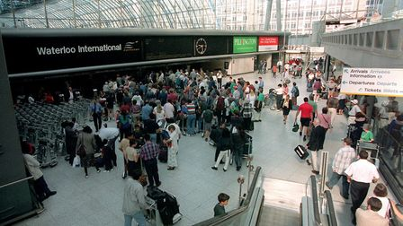 Eurostar passengers at Waterloo shortly after the rail link opened. Picture: Fiona Hanson/PA