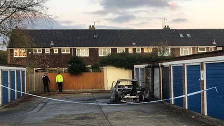 Police are investigating whether the murder is linked to a fire at nearby garages. Picture: Imogen B