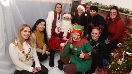 Staff at Viva Dental Studios join Santa in his Grotto at the Hornchurch Christmas Cracker 2019. Pict