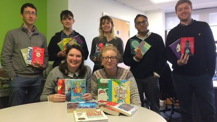 Newham Recorder staff with the books collected for the Christmas Toy Appeal. Picture: Philippa Cave