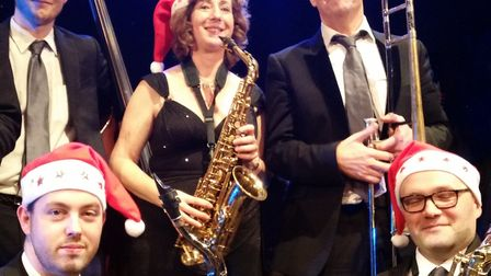 Simone Smith surrounded by Five Star Swing band members. Photo: Chris Smith