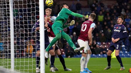 West Ham United goalkeeper Roberto (centre) scores an own goal during the Premier League match at Tu