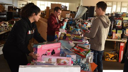 Volunteers sort through donations at the Toy Appeal warehouse. Picture: Ken Mears