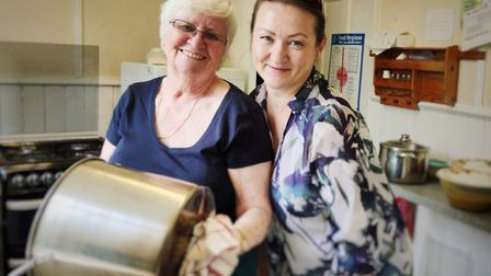 Volunteers Audrone Juciuviene and Maureen Kinsey serving up a hot lunch at Bonny Downs foodbank. Pic