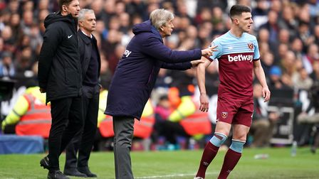 West Ham United manager Manuel Pellegrini speaks to Declan Rice (right) during the Premier League ma