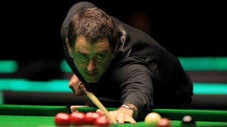 Ronnie O'Sullivan in action against Ross Bulman during day three of the Betway UK Championship at th