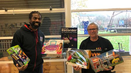 Dave McQueen from RIP Fitness hands over some of the toys he has collected to the Toy Appeal's Paula