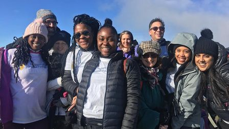 East Ham resident Delores McPherson and family and friends celebrate reaching Snowdon's peak. Pictur