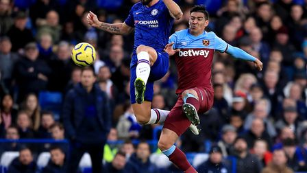 Chelsea's Olivier Giroud (left) and West Ham United's Fabian Balbuena (right) during the Premier Lea