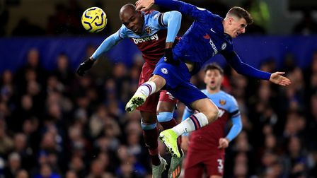 West Ham United's Angelo Ogbonna (left) and Chelsea's Mason Mount (right) battle for the ball during