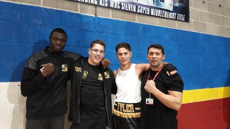 Oladimeji Shittu and Tyler Sharpe with their coaches at Five Star