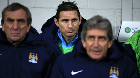 Frank Lampard on the bench with manager Manuel Pellegrini during his time at Manchester City (Pic: N