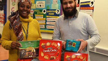 Debbie Ward and Omer Bashir with some of the donations and collecting boxes. Picture: Ken Mears