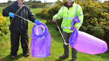 Matthew Horwood (left) and Will Windell take part in a 'Clean For The Queen' litter pick in Southwol