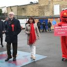 A woman dressed as Elmo tries to approach Labour leader Jeremy Corbyn and his wife Laura Alvarez as