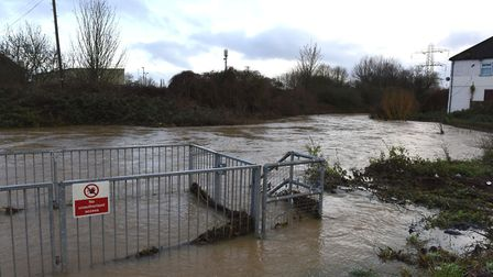 The River Roding in Woodford Green showing a heightened level as it passes alongside Chigwell Road.