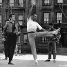 American dancer, choreographer, and director Jerome Robbins demonstrates a dance move to American ac