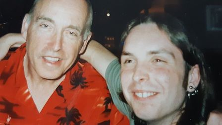 Paul Grove with his dad, Peter, on his 21st birthday in 2001. Picture: Christine Grove.